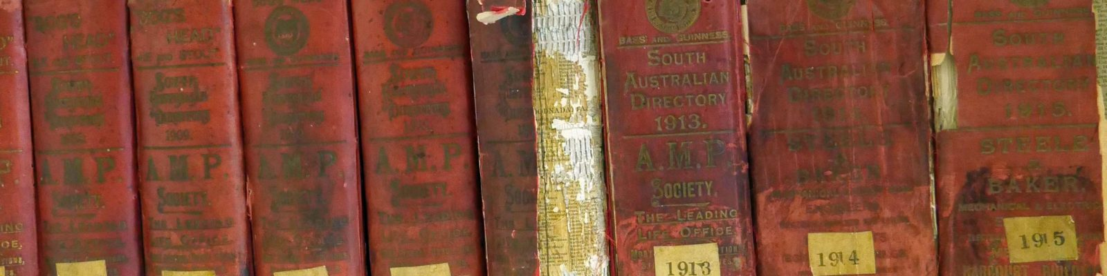 Row of books with years listed on the spines.